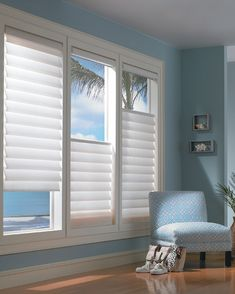 Make an interior space appear more spacious with the glow of diffused light from Vignette® Modern Roman Shades and the use of soft sky-blue colors. ♦ Hunter Douglas window treatments #LivingRoom #tropical