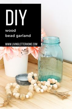 Kirkland's Inspired DIY Wood Bead Garland - Living Letter Home Wood Bead Garland, Diy Garland, Beaded Garland, Farm House Colors, Modern Farmhouse Style, Personalized Signs, Glass Containers, Wooden Crafts, Decor Crafts