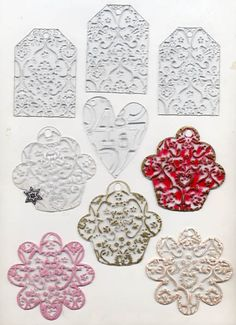 Clear Acrylic Mini Keychain Album Pages by Clear Scraps. These clear minis were embossed using Cuttlebug Embossing Folders. Flowers, Cupcakes, Tags and Heart Shapes.