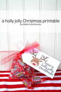 add a holly jolly christmas printable to a bag of candy for a quick and easy gift idea
