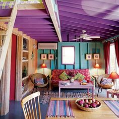 love the colors-- purple ceiling, turquoise wall, magenta curtains!