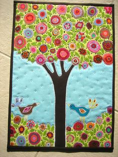 Quilted tree with birds in frame. Adjust colors, flip horizontal, and introduce felted sweater rounds as apples.