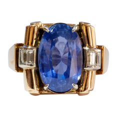 Retro Sapphire Diamond Gold Ring. The natural sapphire weighs 7.29 carats and sits comfortably in this well designed retro diamond 18k gold ring.