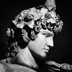 Detail of a colossal statue of Antinous as Dionysos Osiris, marble, Roman, Vatican Museums, Rome, Italy.