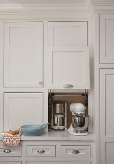 Amazing kitchen features gray shaker cabinets fitted with a small kitchen appliances garage cabinet filled with a coffee machine and KitchenAid Mixer.