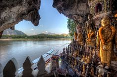 Buddha statues in lower Pak Ou Cave on the Mekong River north of Luang Prabang, Laos. (bordered by Burma and China to the northwest, Vietnam to the east, Cambodia to the south and Thailand to the west)