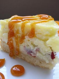 WHITE CHOCOLATE CRANBERRY CHEESECAKE WITH CARAMEL SAUCE