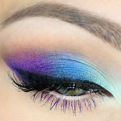 STEPS - ① place aqua e/s (fromTreasure Island Isadora) in the inner corner, then follow by navy  blue (Mac Deep Truth) on the center of the lid. ② line the lash line with gel liner (by L'Oreal nr 01) and then place purple e/s (from Circus palette Sleek) in the outer corner, then with angles brush; apply a line underneath the black winged part and blend it out. ③ blend all the colors in the crease using nude matte eyeshadow (from Au Naturel palet...
