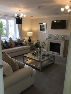 Neutral cream and grey living room fire place glass coffee table