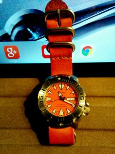 Seiko Orange Monster Japan Automatic Diver Day Date on burnished leather Nato Strap. Seiko Marinemaster, Seiko Monster, Seiko Diver, Nato Strap, Seiko Watches, Japan, Orange, Leather, Style