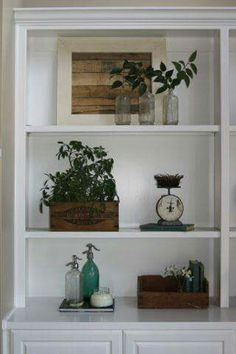 Glass bottles, wooden accents, and that weight scale with old book what's not to love!