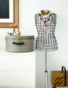 Chic Standing: A hat box and a bust to display your necklaces are always a must.