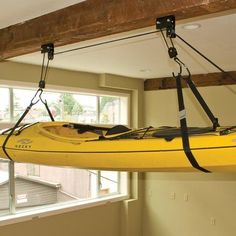 The Sherpak Hoist is an all-purpose garage storage solution. This heavy-duty hoist will also lift bikes or storage boxes right to the ceiling of your garage. Built with heavy-duty pulleys and rope, this hoist is capable of lifting one hundred pounds. Kayak Storage Rack, Kayak Rack, Shed Storage, Storage Boxes, Kayak Garage Storage, Garage Hoist, Fishing Storage, Hanging Storage, Kitchen Storage