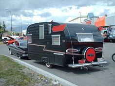 59 Chevy and vintage camper with 'cat eye' tail lights to match