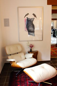 "No one EVER regrets buying an Eames Lounge Chair.  This is the corner of the dining room, and it successfully takes the formal out of the dining.  Shana Frase's ""Hitchcock Blond"" hangs above it."