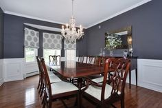 Traditional Dining Room with Crown molding, Carved Polished Mahogany Finish Chippendale Armchair, Chair rail, Bay window