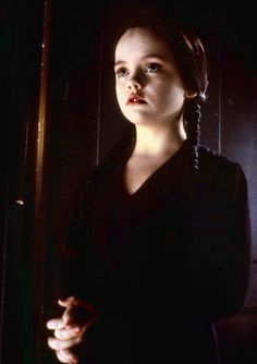 Christina Ricci as Wednesday in the Addams Family movies. Best little goth girl ever!