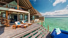 Water Villa with a sea-gazing loft and plenty of lounging outdoor space.