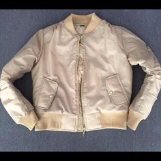Women's Tan Beige Bomber Jacket- SMALL Unbranded. Beige tan bomber jacket. This satin nylon bomber is a size SMALL. New, never worn. Contact us with any questions. Jackets & Coats Puffers