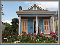 A splash of color is just what New Orleans needed this Spring ! This Historic home in Mid City fits the bill for the garden of the week ! These splashes of color mean someone spent a lot of time planting and replanting after one of the colder Winters New Orleans has had in years.