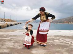 traditional fold clothing ... Cretan, Greece ... mom spins her sweet little girl wearing the same costume ...