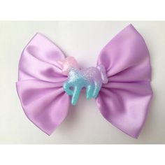 Fairy Kei Unicorn Hair Bow Pastel Purple Kawaii (6.55 AUD) ❤ liked on Polyvore featuring accessories, hair accessories, bow hair accessories and purple hair accessories