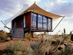 I like the canvas awning/shade for the house.  Australia tiny house living off the grid