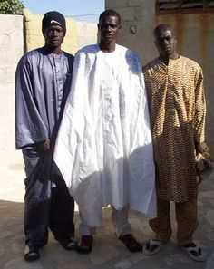 A Boubou is a traditional outfit worn by men. Boubous may come in diffferent sizes and shapes.  Families may wear matching outfits to distinguish themselves from others.