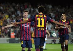 Barcelona's Argentinian forward Lionel Messi (L) celebrates his goal with Barcelona's Brazilian forward Neymar da Silva Santos Junior during the Spanish league football match FC Barcelona vs Real Sociedad at the Camp Nou stadium in Barcelona on September 24, 2013