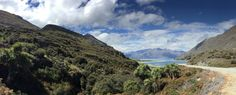https://flic.kr/p/NsdR7T | 2050ex2 NZ countryside pano | Crossing the middle of the South Island of New Zealand, this is the rugged land between Lake Wanaka and Lake Hawea.  This is typical vegetation-- low lying shrub and the cabbage tree, or cabbage palm.  The waters are a beautiful aqua blue since their source is glacial melt.  Check back to my album 2016 Australia, New Zealand and French Polynesia   -- should be posting more ( almost) daily…