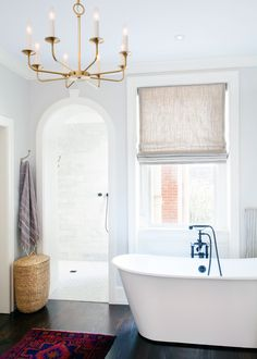 A stunning colonial home renovation in Philadelphia with beautiful modern twist. Gorgeous white bathroom, big fireplaces and stunning fixtures like the chandeliers.