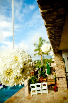 Photo by True Photography Weddings  Flower Kissing Ball by Dianna Basacchi