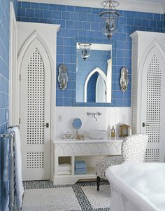 This Moorish-style bath designed by Robin Bell has cooling cobalt blue glass tile and a glittering tile mosaic floor.