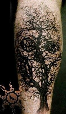 tree skull tattoo design on leg