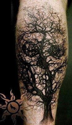 tree skull tattoo design on leg