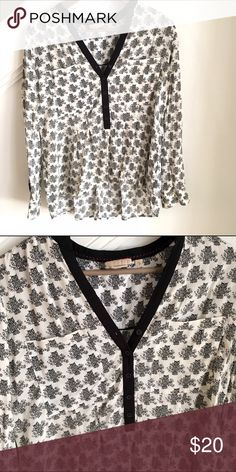 Anthropologie (Vanessa Virginia) blouse Black and white, loose blouse from Anthropologie. Excellent condition, worn a few times only. US size 6. Fabric is 100% rayon. Anthropologie Tops Blouses