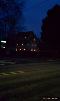 This house has a candle in every single window.  It looks eerie at dusk.