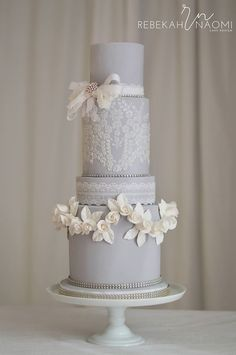 Lace Wedding Cakes soft gray and white lace wedding cake with lace ribbon brooch bow Floral Wedding Cakes, White Wedding Cakes, Elegant Wedding Cakes, Elegant Cakes, Wedding Cake Designs, Lace Wedding, Trendy Wedding, Wedding Grey, Floral Cake
