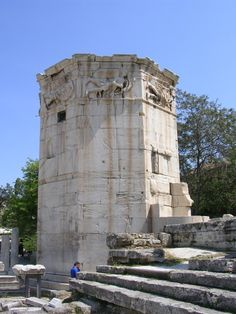 the Tower of the Winds because of the relief carvings of the eight winds near its top, this marbel tower, built in the first century BC, contained the clock which ran on water from the Acropolis spring. It was located in the Roman agora.