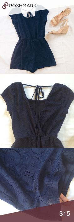 Maurice's Blue Lace Romper Absolutely adorable lace romper! Dark navy blue color. Soft polyester lining with lace polyester top. Short sleeves. Scoop neck and deep V in the back. In great condition, except for a few flyway thread on front neckline and the one tie in back is worn pretty badly. You could very easily replace the tie strings though (navy blue fabric is easy to find) and snip the threads. Maurices Other