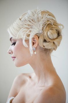 updo with feathers add veil for ceremony add clip at reception?