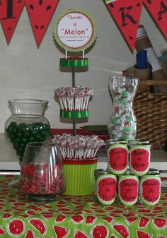 """Watermelon Themed Party: Watermelon candy bar: watermelon salt water taffy, watermelon gum ball, Watermelon dum dums, Watermelon hard candy. The """"thanks a melon jars were for them to put candy in and take with them as their favor."""