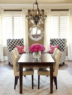 similar to set up of my small dining/living area - like this. >The back chairs are brough in closer to the dining area to set an atmosphere of inclusion. I love the neutral tones emblished with hot pink, and crystals/mirrors. I need a dining room!