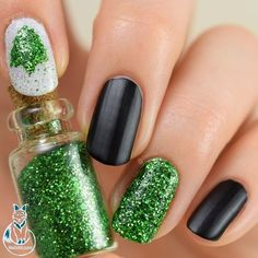 Nothing gets you in the #holiday mood faster than #glitter and #christmas trees!  Match glitter up with a #matteblack #nailpolish and we are ready to sing a round of #jinglebells while drinking a nice #cold glass of #eggnog! #Nailart: @nailzini on #Nailstyle