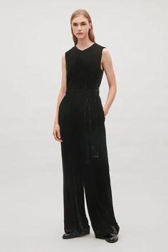 COS image 1 of Belted velvet jumpsuit  in Black