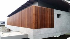 Contemporary entrance screen. Love the narrow slats, for more visit timbertrends.co.za