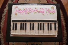 Her mother and sister wanted a piano (or keyboard) cake since she is taking lessons. The keys and black strip across the cake were made from chocolate. I molded it and cut them to size (all keys are accurate size and spacing). The rest of the cake is all buttercream.