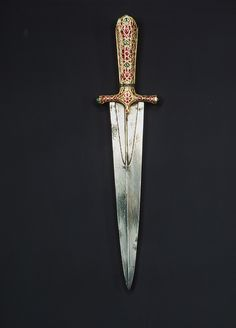 Dagger with jeweled hilt, Mughal period (1526–1858), ca. 1605–27  Northern India  Hilt: gold, rubies, colored glass; blade: crucible steel; scabbard: wood, velvet; gold inset with rubies and colored glass