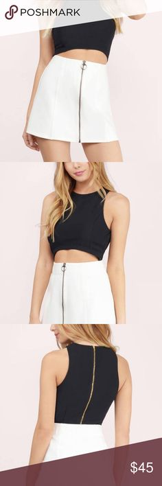 White Zip Up Skirt Purchased new and never worn. Sold out now on Tobi.com. Zip Up front, mini skirt silhouette. Tobi Skirts Mini