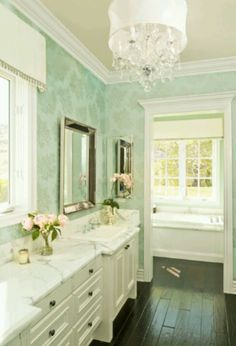 Light mint green wallpapered bathroom